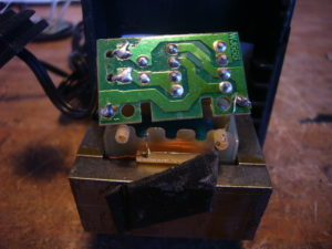 Photograph of a printed circuit board inside a power pack.
